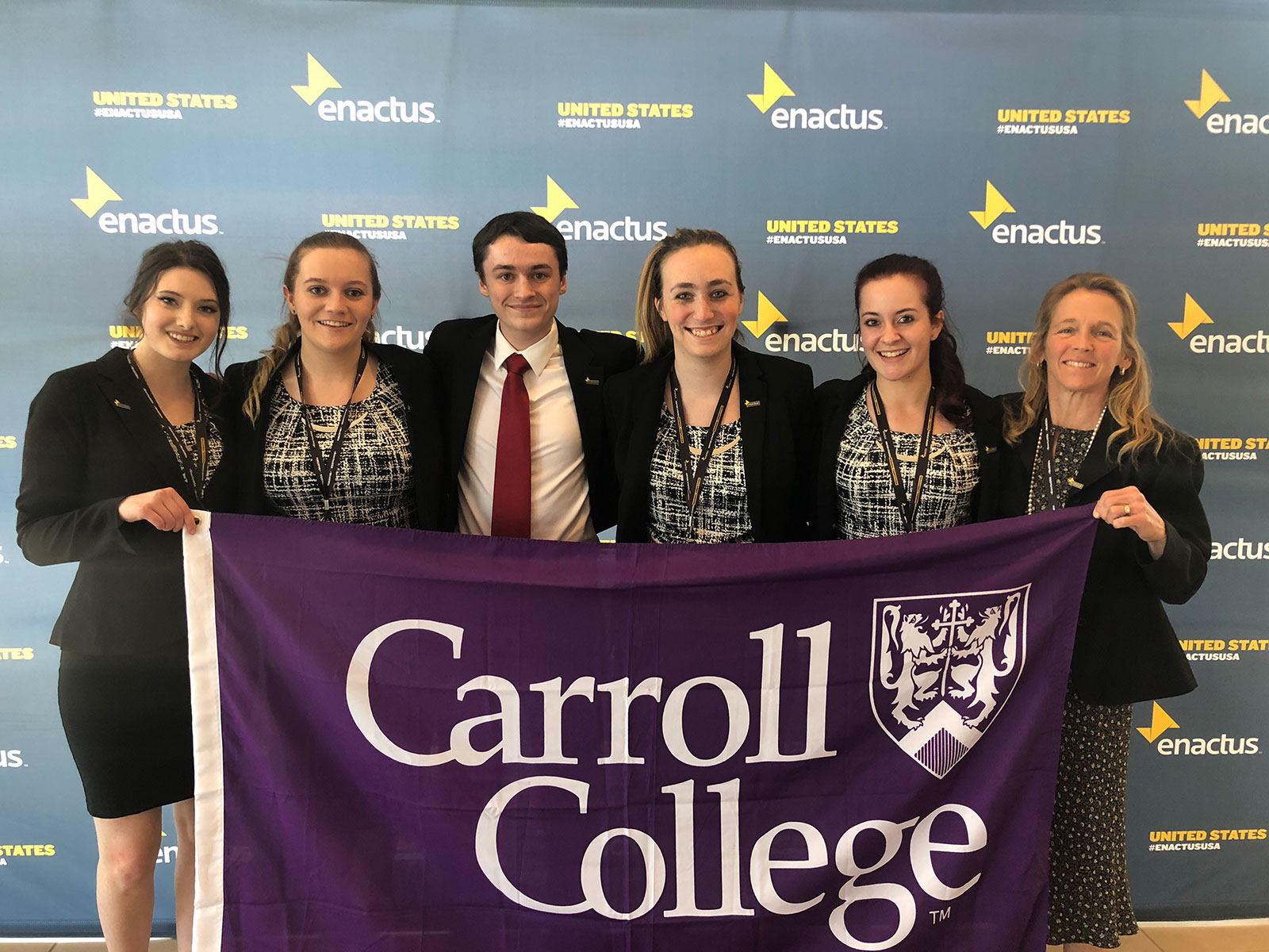 Carroll College Students with Carroll College Flag