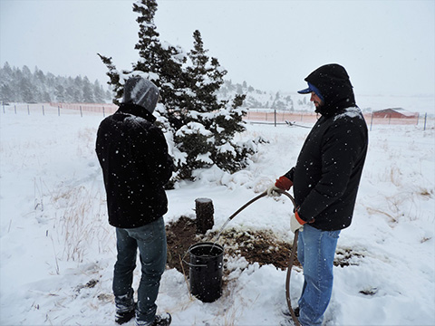 Hydrogeology Students working in a very snowy field