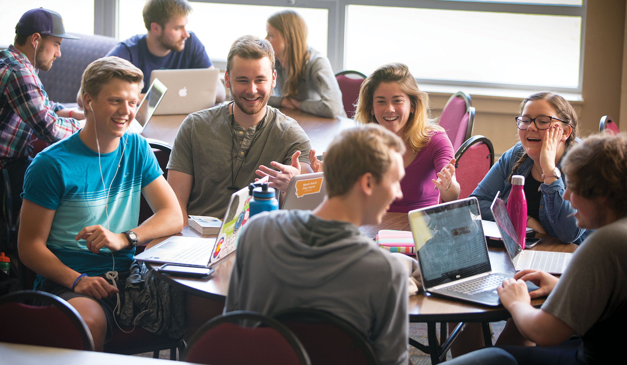 Group of students at table in Campus Center