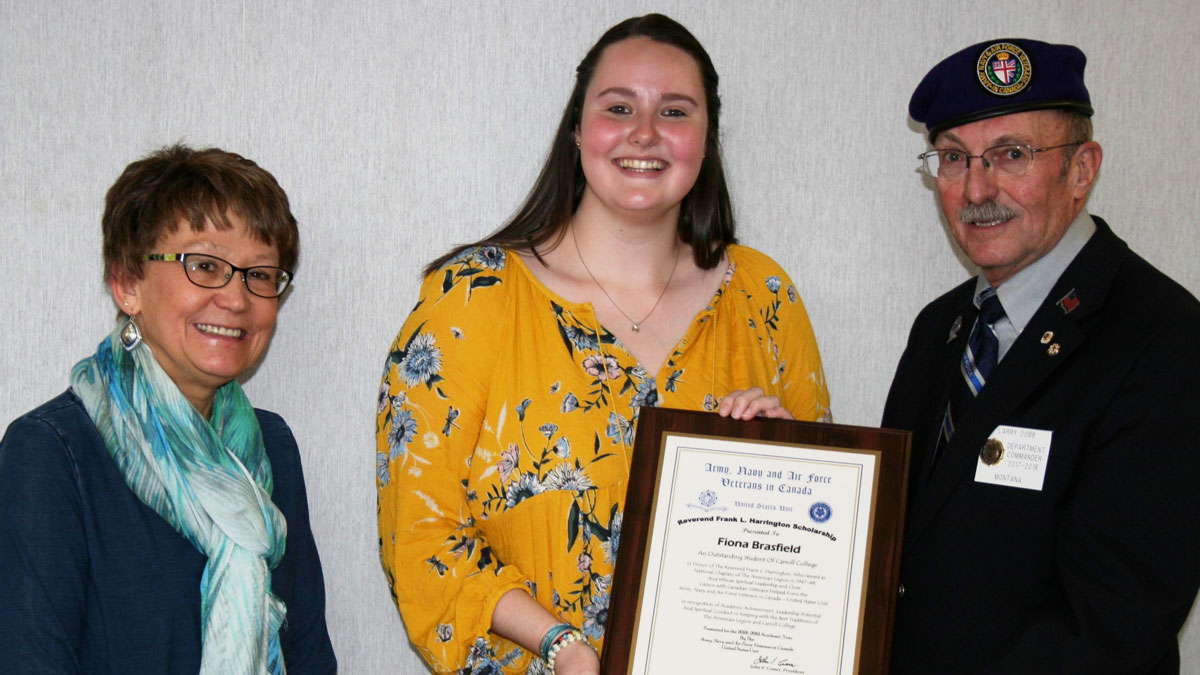 Photo of Fiona Brasfield receiving the Reverend Frank Lawrence Harrington (ANAVICUS) Scholarship