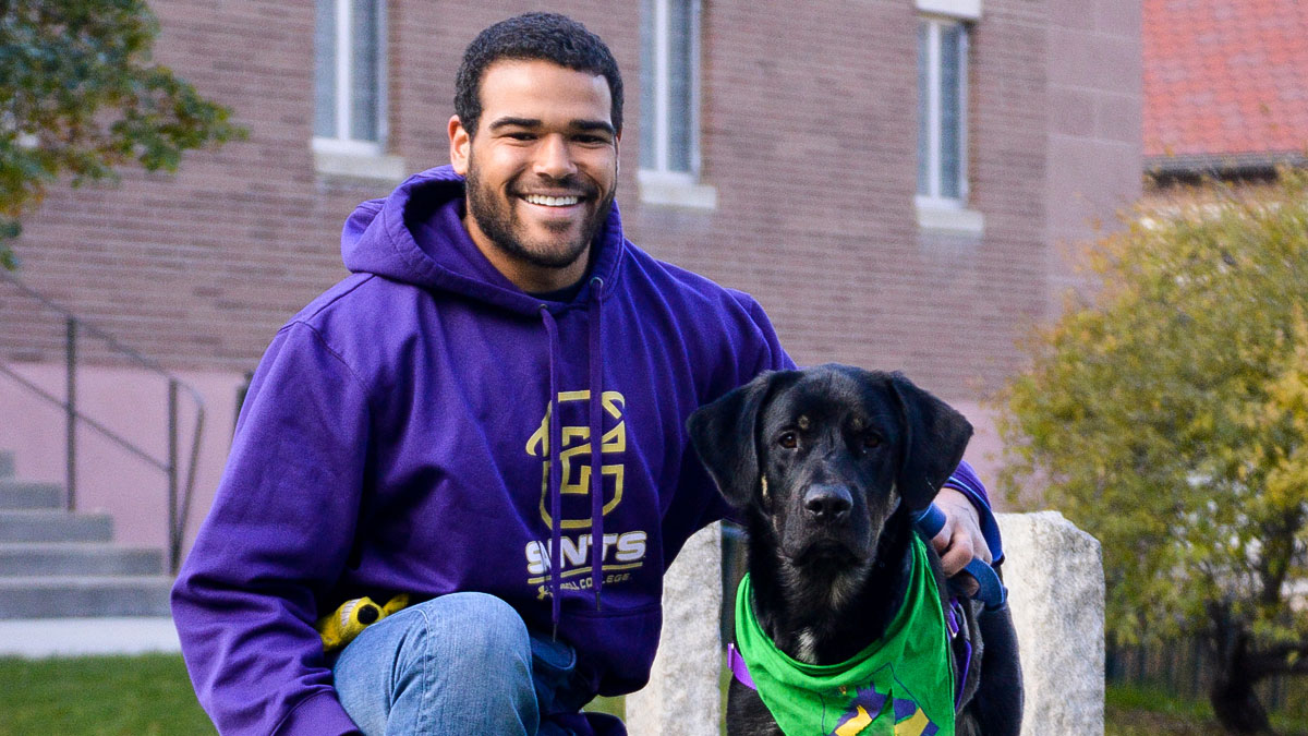 Male student and dog