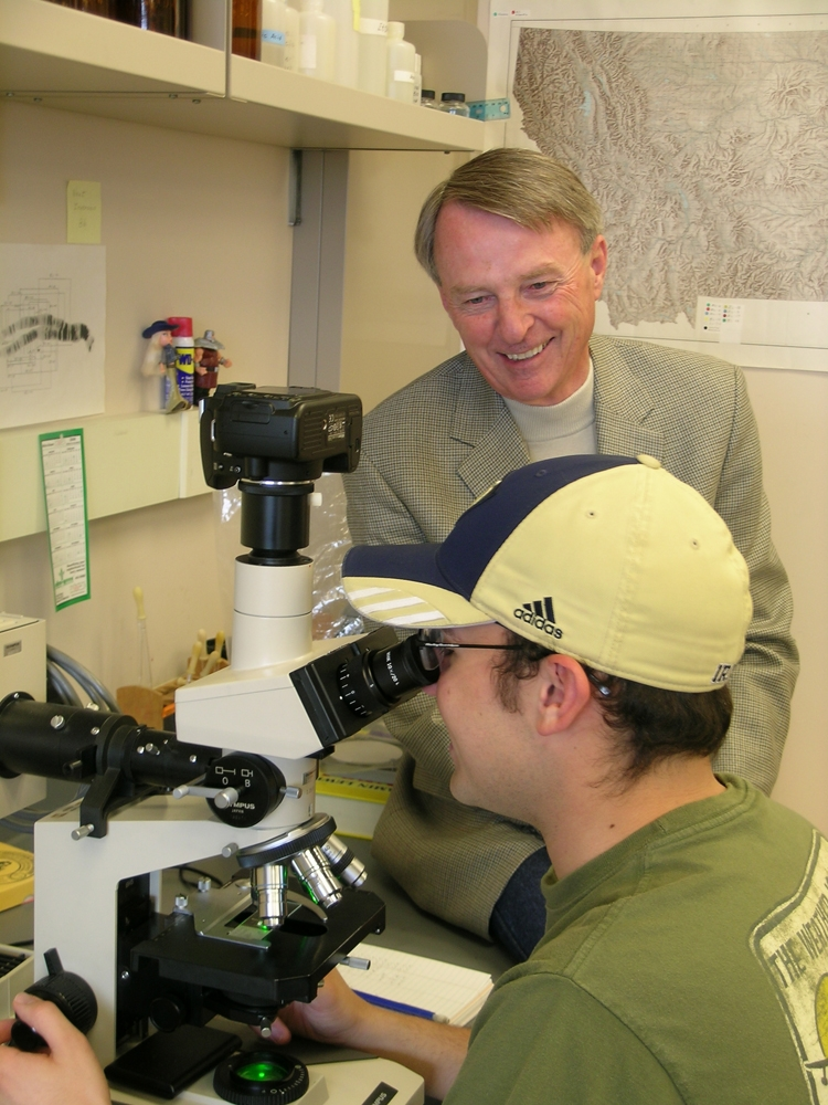 Professor working with a student during lab