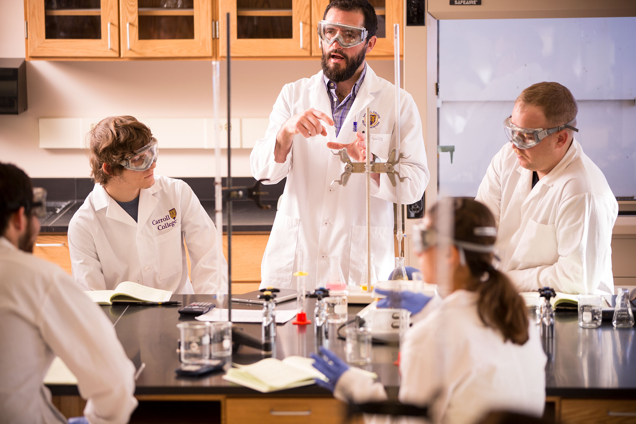 Dr. John Rowley teaching students in a lab