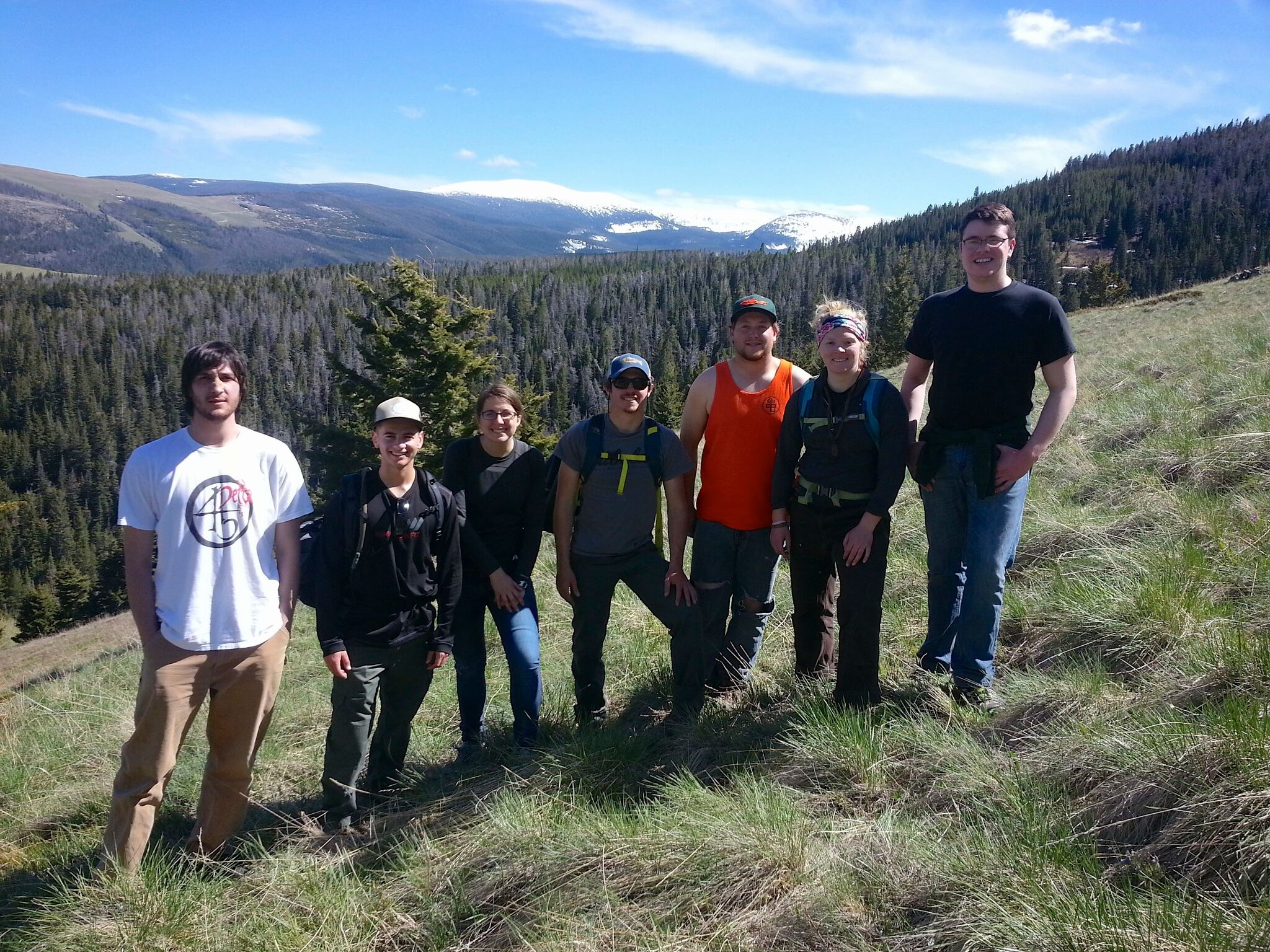 Students in Environmental Outreach & Interpretation standing on a hill