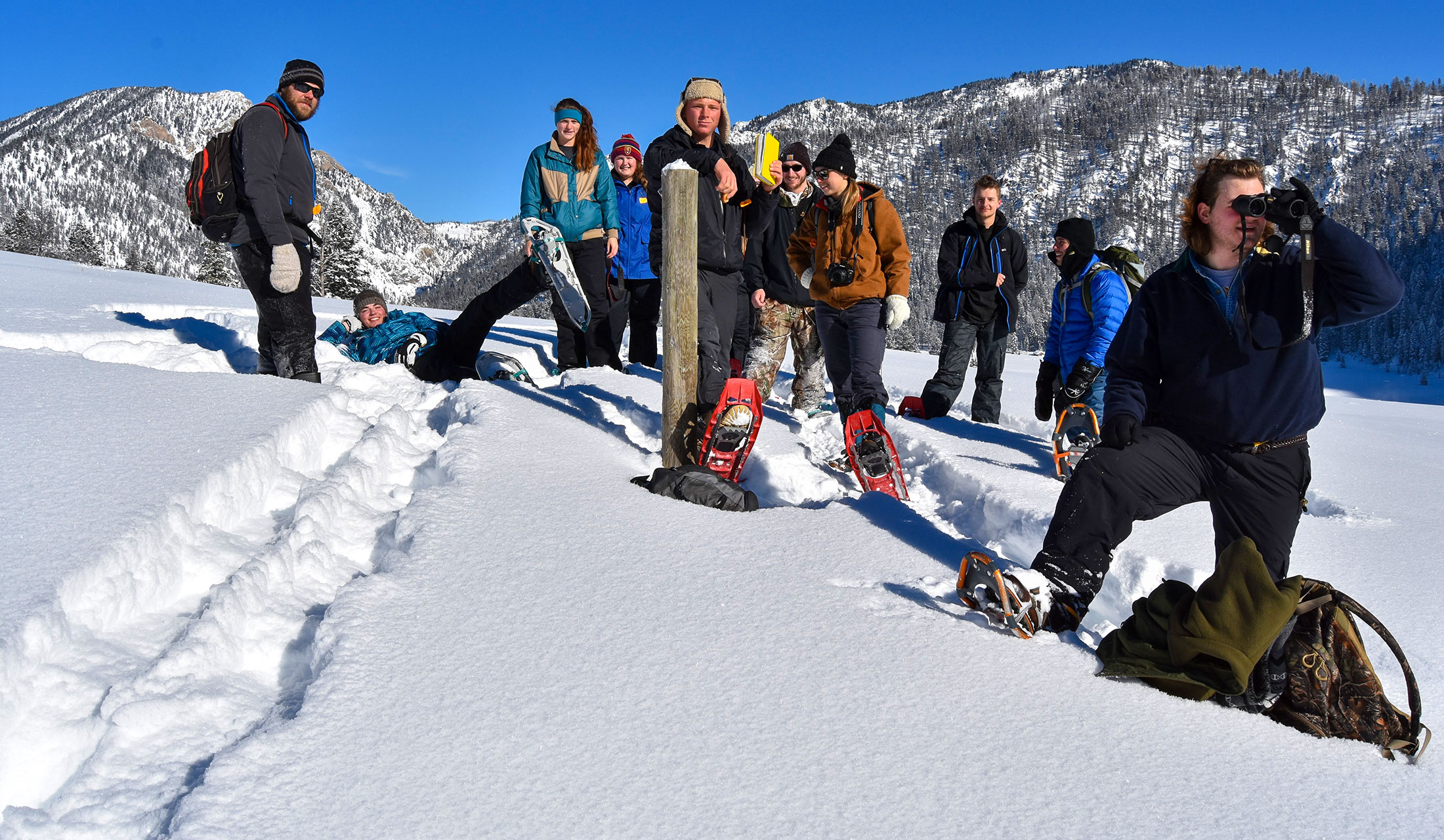 Students on snowy mountainside during winter ecology trip