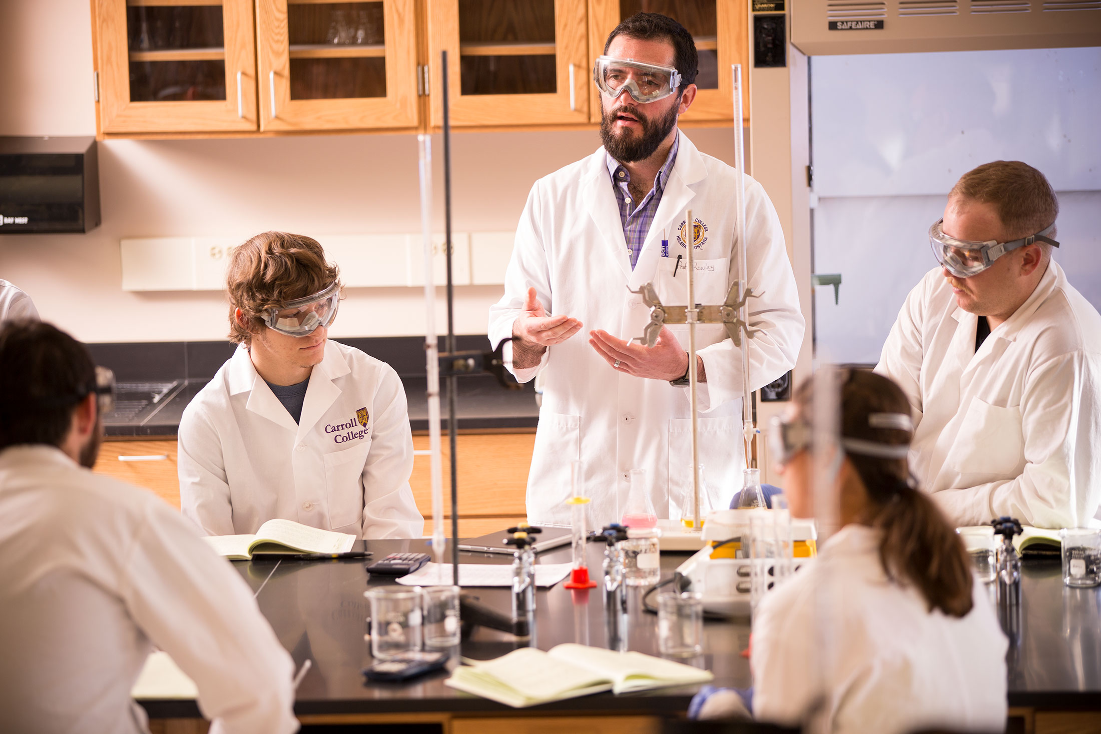 Professor John Rowley teaching a lab with students.