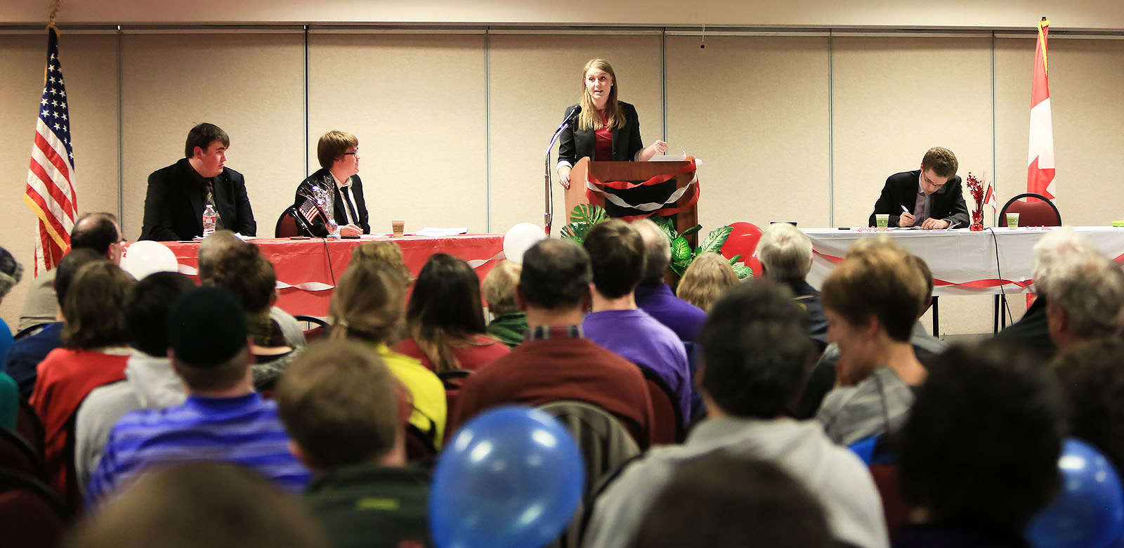 A student speaks in front of a crowd, Carroll College Forensics