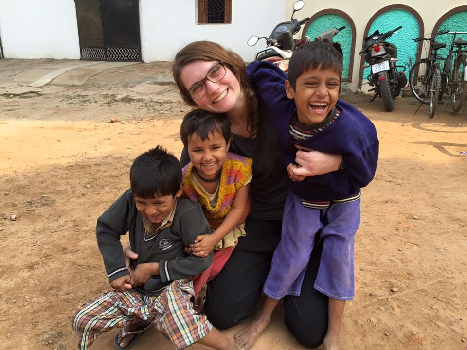 Photo of student with children
