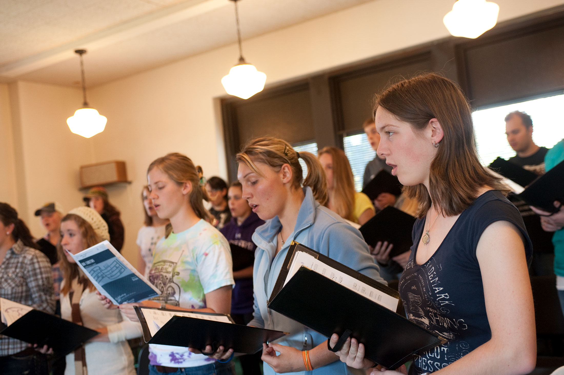 Image of Choir Singing and holding Song Books