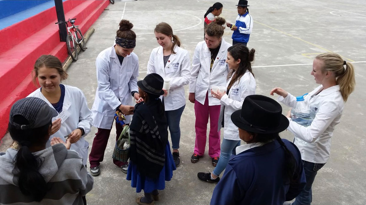 Nursing students talking to the people of Ecuador
