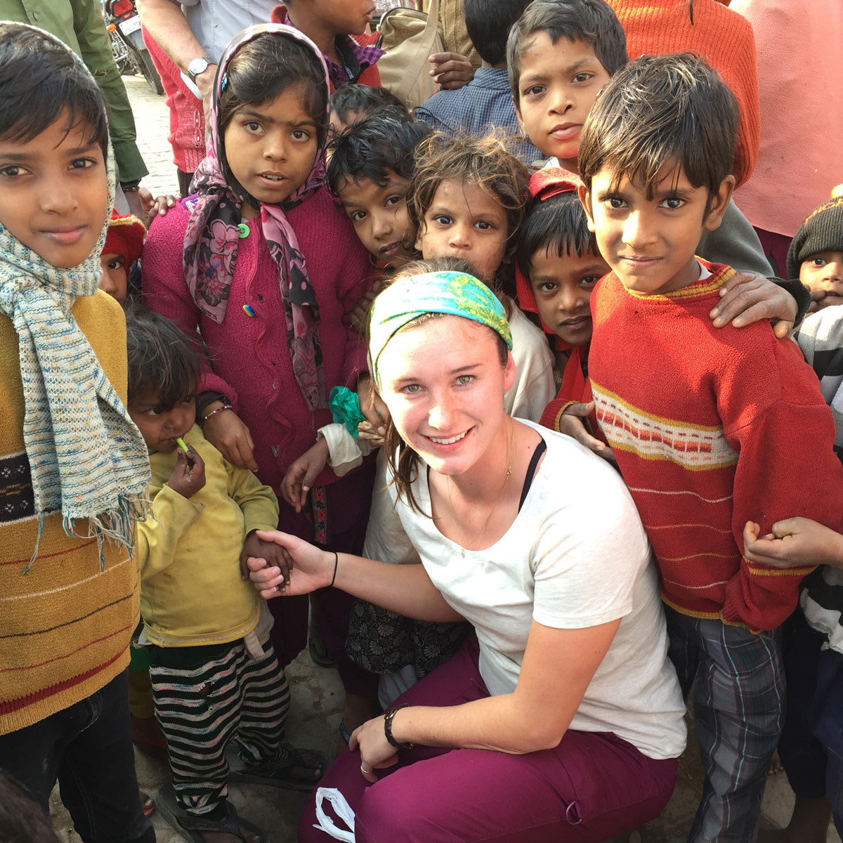 Nursing student in India with children