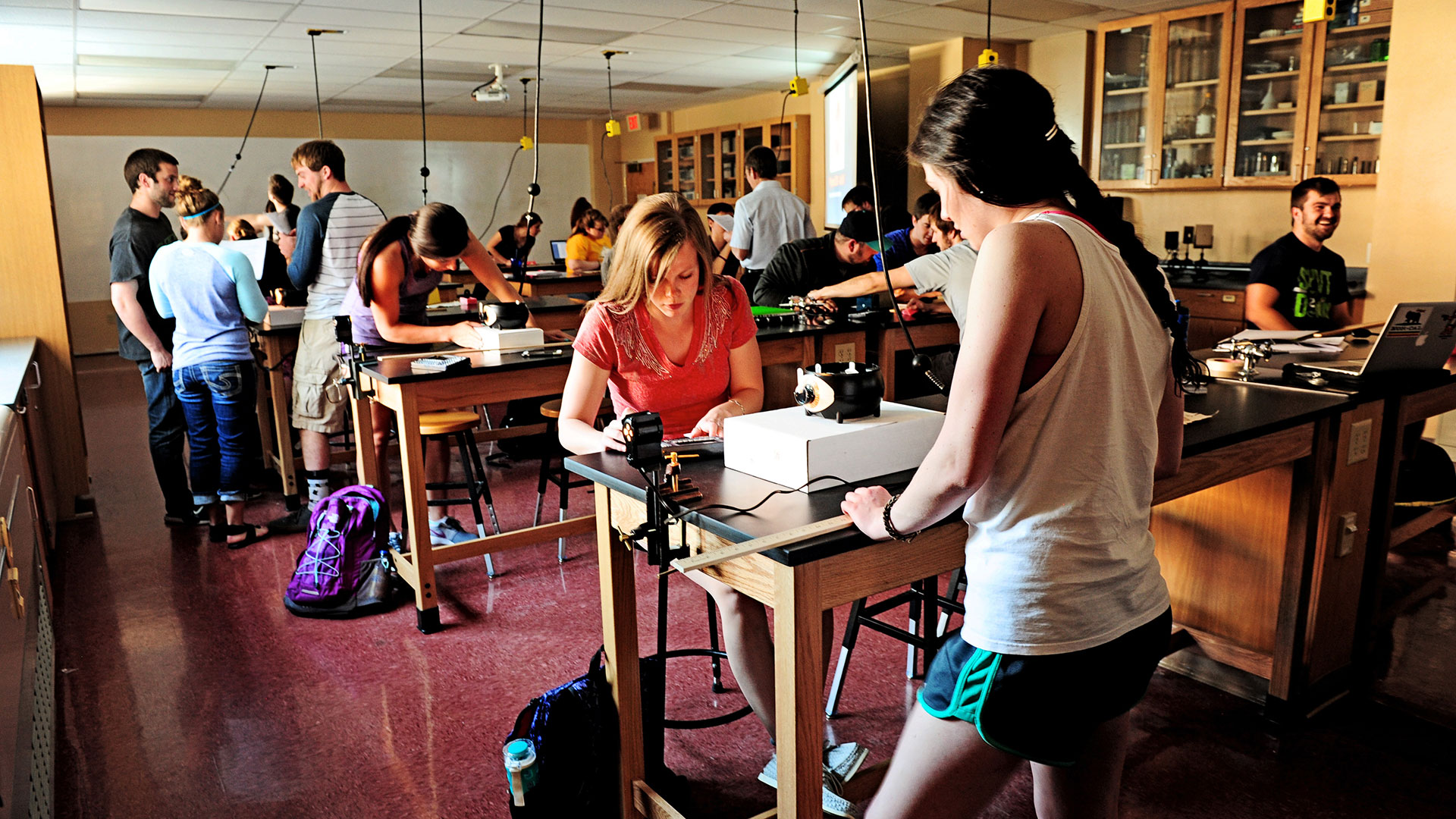 Photo of Students in Physics Lab