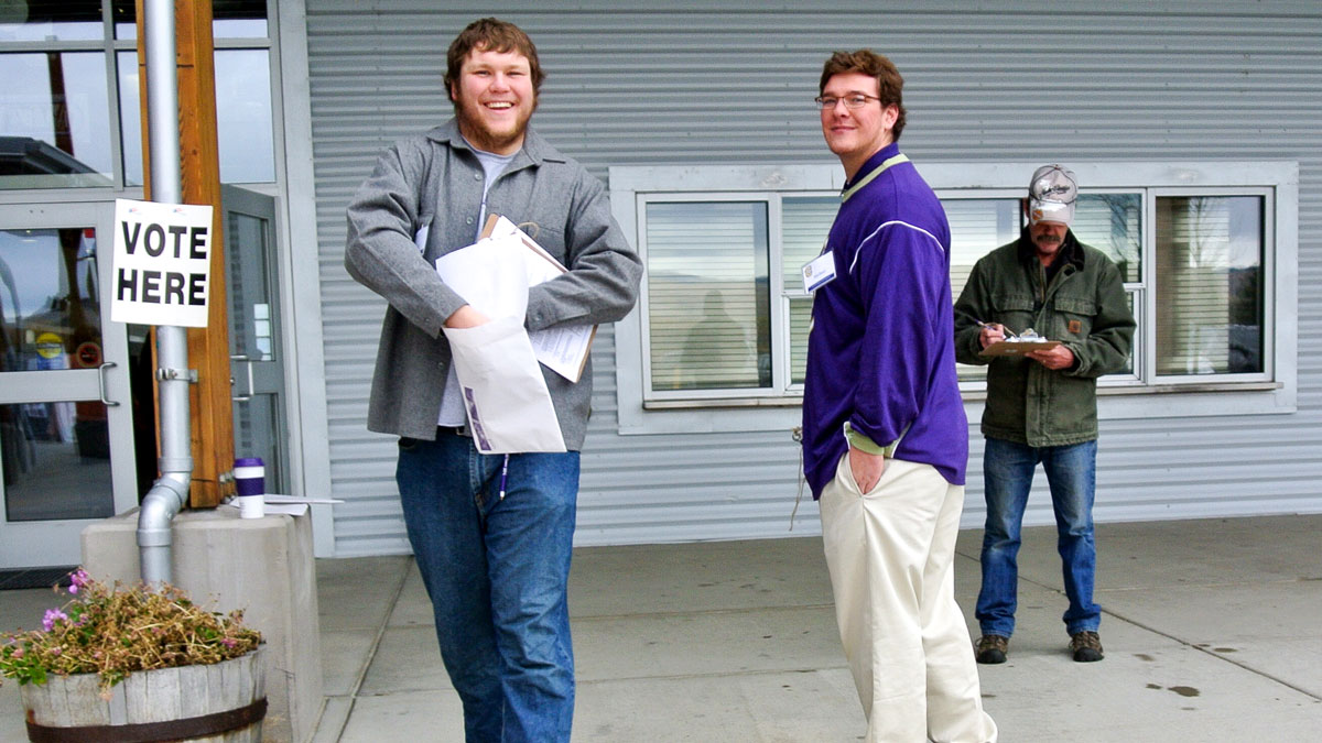 Photo of two Carroll students taking exit polls
