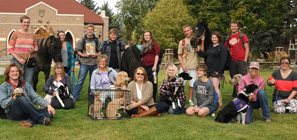 Image of pre-vet students posing with a variety of animals