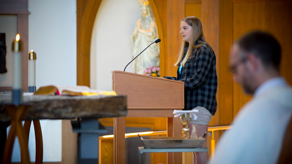 Student speaking at Chapel Mass