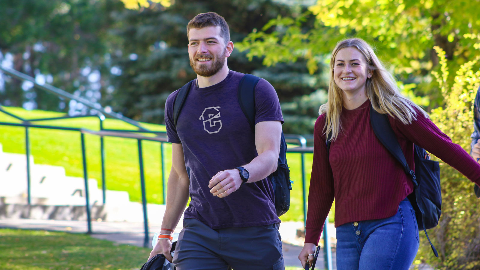 Two students in walking up path