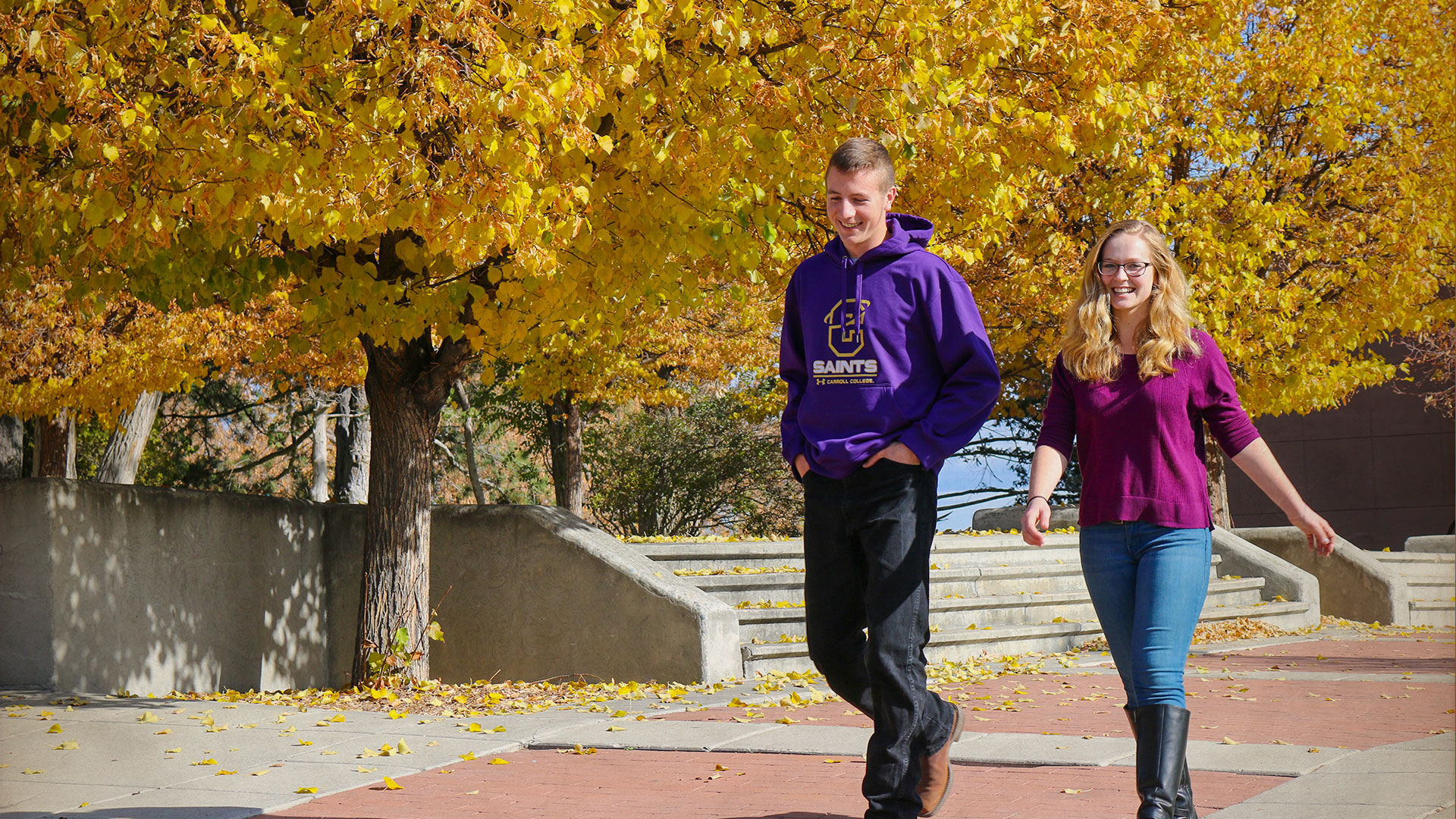 Image of Carroll Students walking on campus in the fall