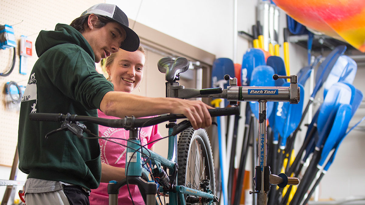 Two students fixing bicycle
