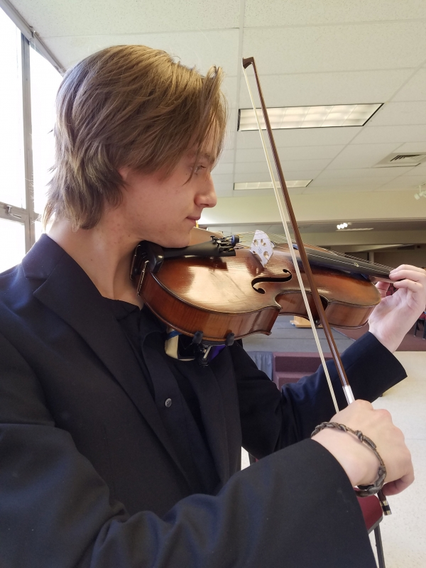 Michael Larson warming up for a special event down in the cube. Viola player