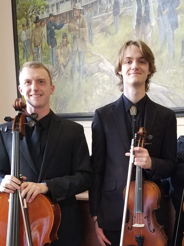 The Carroll College string Ensemble left to play for the local Carroll College Mass. Here are David woolston cello, and Michael Larsen on viola for a Mass in the Cube. spring 2017