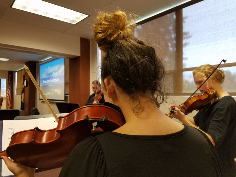 The Carroll College string Ensemble is often asked to play for special musical events at Carroll College. Here The Ensemble is playing for a presidents update and the cube. Sam Sampson, Brianna Bivens and Elizabeth Hodgson