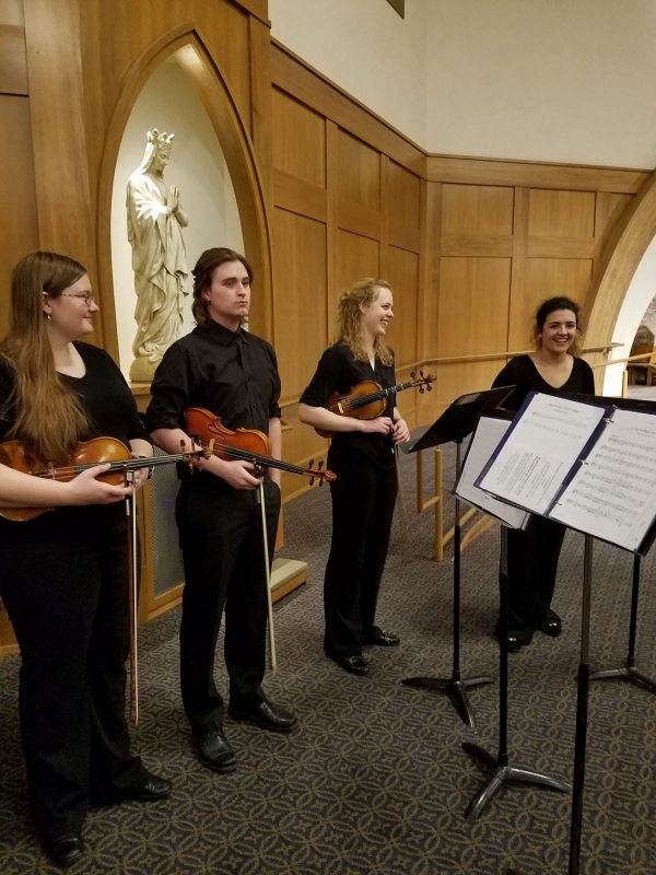 We like to be part of the Carroll College Masses. Here we are performing in the new Chapel on campus, for Prelude. We have Beth Grabowski, Sam Samson, Elizabeth Hutchins and Brianna Bivens.