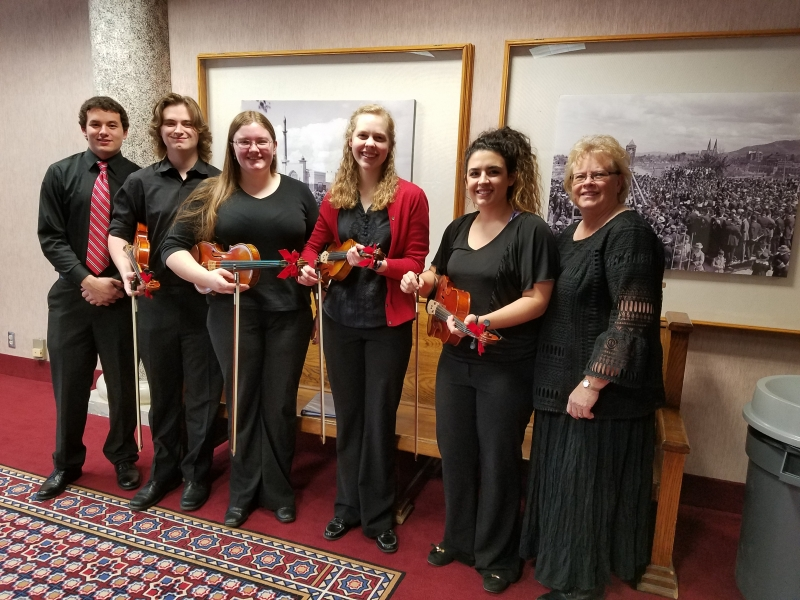 Carroll College string Ensemble performed at the festival of trees in December of 2017 here we are in the Civic Center lobby, before our performance. We had a drummer that joined us for our Wizards in Winter peace. Left to Rt: Dan Brady, Sam Sampson, Beth Grabowski, Elizabeth Hodgson, Brianna Bivens, and director Linda Meuret.