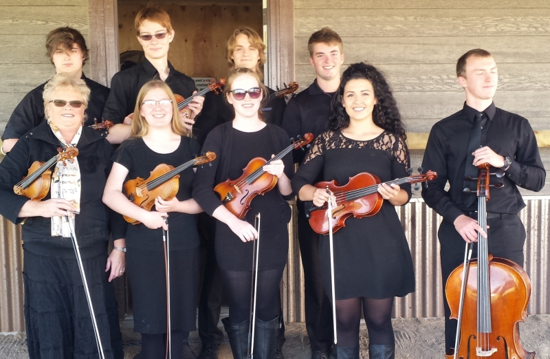 For the open house for the zoology Department in Fall of 2016, the string Ensemble performed outside under one of their rustic buildings