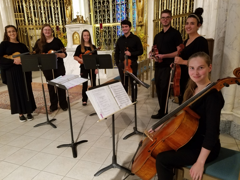 Carroll College String Ensemble playing in the Cathedral of St. Helena
