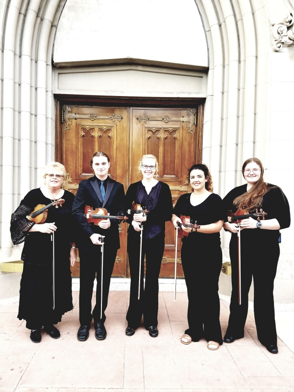 Each semester, the Carroll College string Ensemble plays at the Cathedral in Helena. We often play Prelude, or during the service. Pictured is director Linda meuret, Sam Sampson. Elizabeth Hodgson. Brianna Bivens, and Beth Grabowski