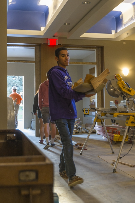 Students help move in pews