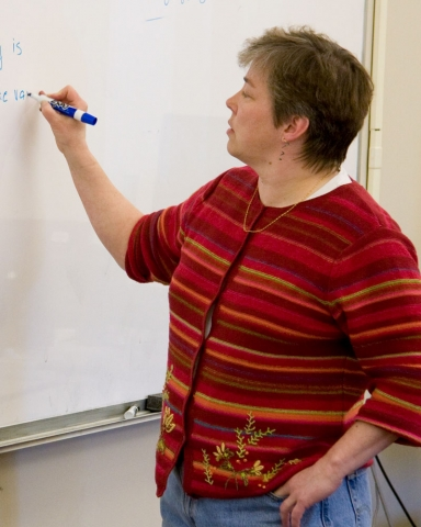 Mary Keeffe Writing on a White Board