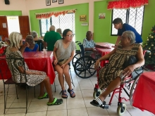 Students with the elderly in St. Lucia