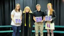 Image of students receiving the Hunthausen Outstanding Citizenship Award