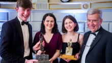 Brent Northup with the Irish Times debate championship winners - Eoghan Quinn, Aislinn Carty and Rachael Mullally.
