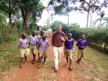 Alex Woelkers walking with young students abroad