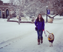 Breanna walking Anna in the snow on campus