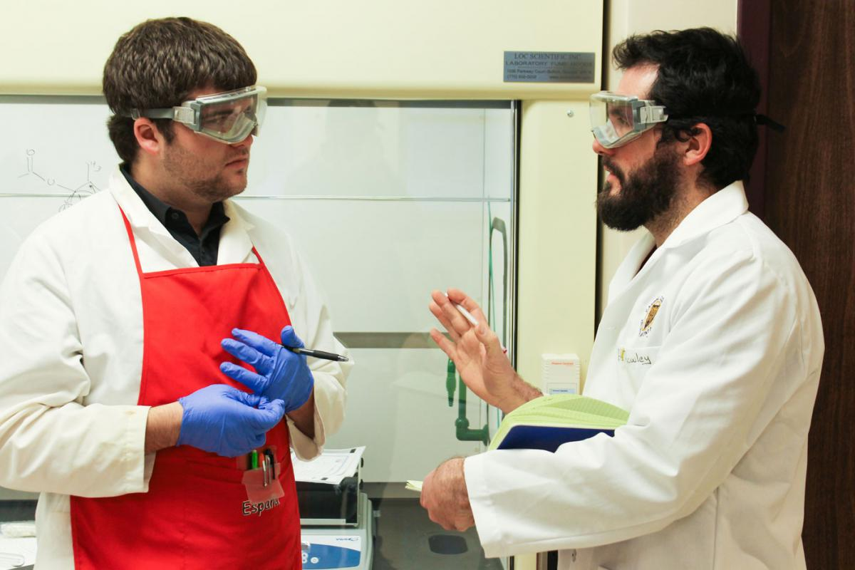 Dr. John Rowley with a student in the Chemistry Integrated Lab